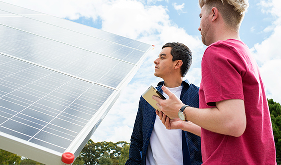 Curtin University researchers studying a solar panel.