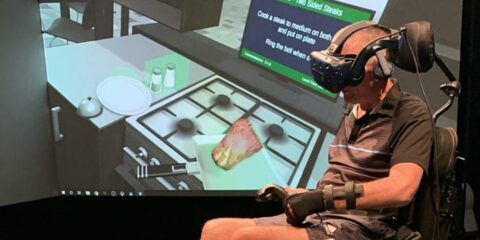 Man with spinal injury using VR to re-learn how to move