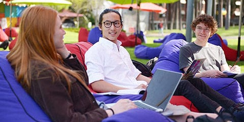 Three students sitting on beanbags