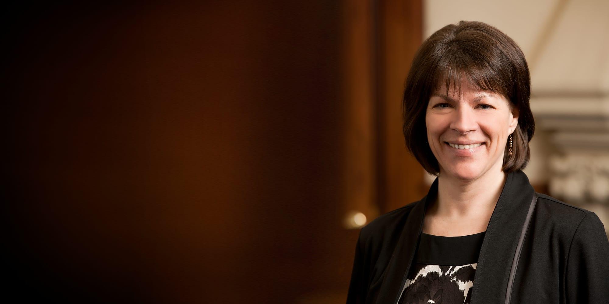 A portrait photograph of Professor Harlene Hayne smiling