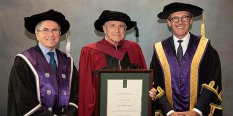 Kerry Stokes standing with honorary Doctorate of Science awarded by Curtin.
